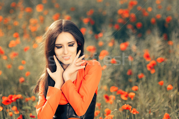 Beautiful Woman in a Field of Poppies  Stock photo © NicoletaIonescu