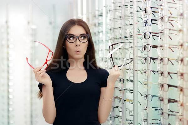 Woman Choosing Eyeglasses Frames in Optical Store Stock photo © NicoletaIonescu