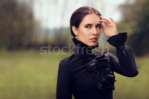 Beautiful Dark Princess in Nature Stock photo © NicoletaIonescu