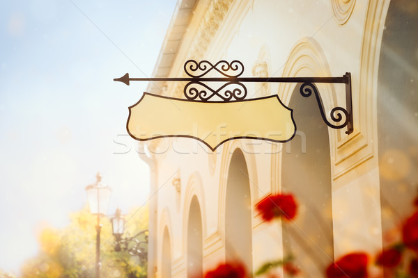 Building with a Wrought Iron Sign Stock photo © NicoletaIonescu