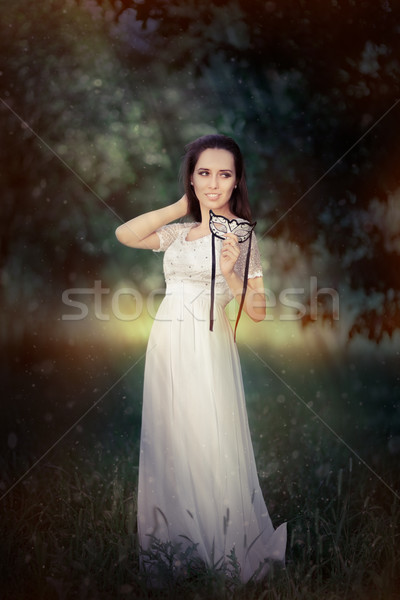 Young Woman in Long White Dress Wearing Mask  Stock photo © NicoletaIonescu