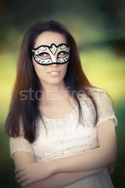 Young Woman in White Dress Wearing Mask  Stock photo © NicoletaIonescu
