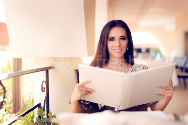 Happy  Woman Choosing from Restaurant Menu Stock photo © NicoletaIonescu
