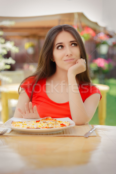 Young Woman Refusing  To Eat a Pizza Stock photo © NicoletaIonescu