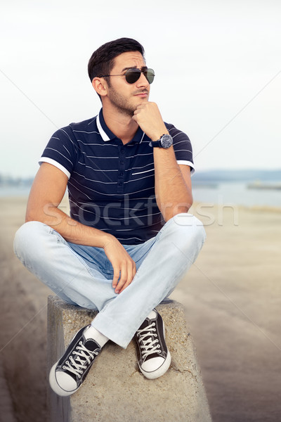 Stock photo: Young Man Thinking by the Water