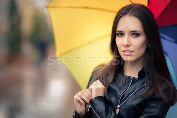 Beautiful Girl Holding a Rainbow Umbrella in Autumn Rain Decor Stock photo © NicoletaIonescu