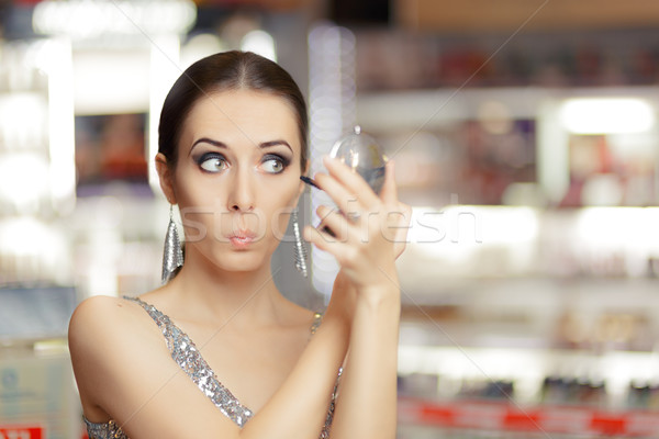 Sorpreso donna mascara trucco specchio cool Foto d'archivio © NicoletaIonescu