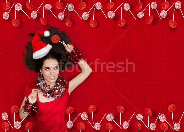 Stock photo: Happy  Christmas Girl Holding a Lollipop on Red Textured Background