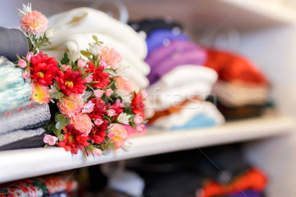 Flower Bouquet on Clothing Shelf  Stock photo © NicoletaIonescu