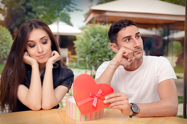 Girl Disappointed on Her Valentine Gift From Boyfriend Stock photo © NicoletaIonescu