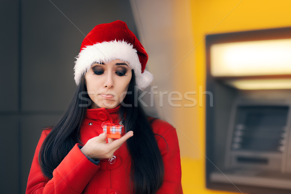 Hayal kırıklığına uğramış kadın küçük hediye kutusu ATM üzücü Stok fotoğraf © NicoletaIonescu