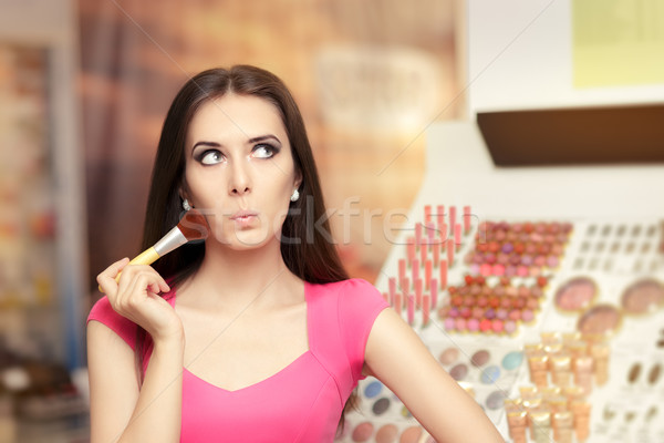 Surprised Girl Holding a Make-up Brush Stock photo © NicoletaIonescu