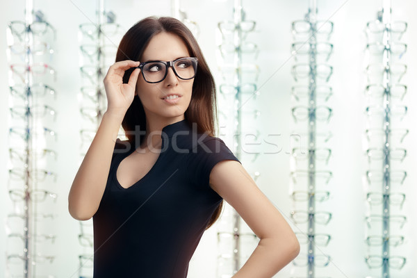 Young Woman with Eyeglasses in Optical Store Stock photo © NicoletaIonescu