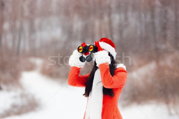 Kız dürbün bakıyor Noel mutlu kadın Stok fotoğraf © NicoletaIonescu