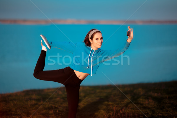 Girl in Yoga Pose Taking a Selfie Outside in Nature Stock photo © NicoletaIonescu