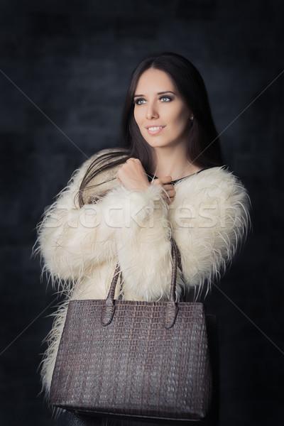 Mooie winter vrouw pels zak fabelachtig Stockfoto © NicoletaIonescu