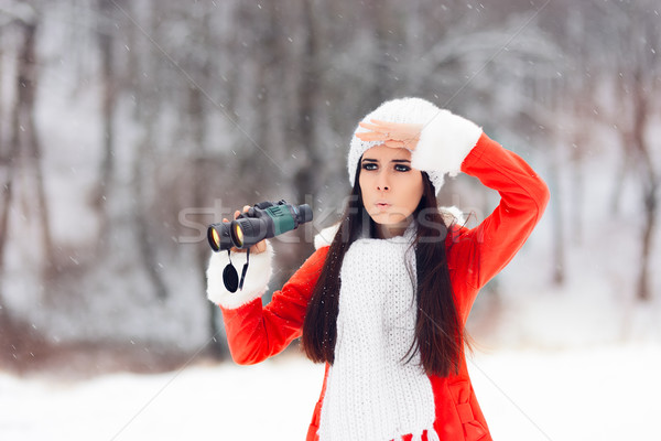 Surprised Winter Woman with Binoculars Looking for Christmas Stock photo © NicoletaIonescu
