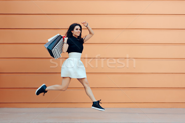 Happy Woman Running With Shopping Bags in Summer Sale Season Stock photo © NicoletaIonescu