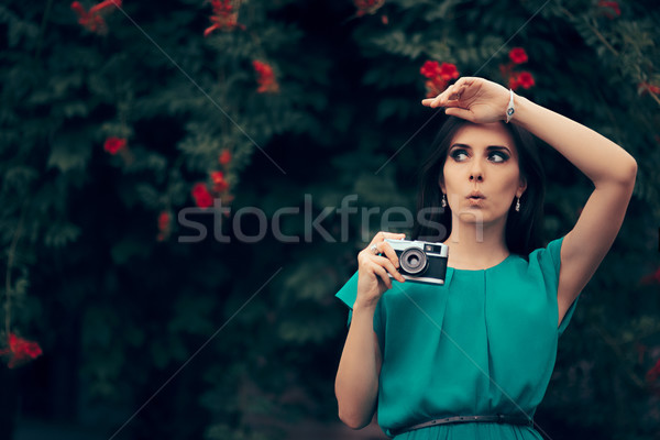 Funny Woman with Vintage Camera at a Garden Party Event Stock photo © NicoletaIonescu