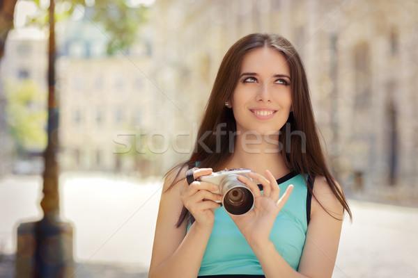 Happy Elegant Woman with Compact Digital Camera Stock photo © NicoletaIonescu
