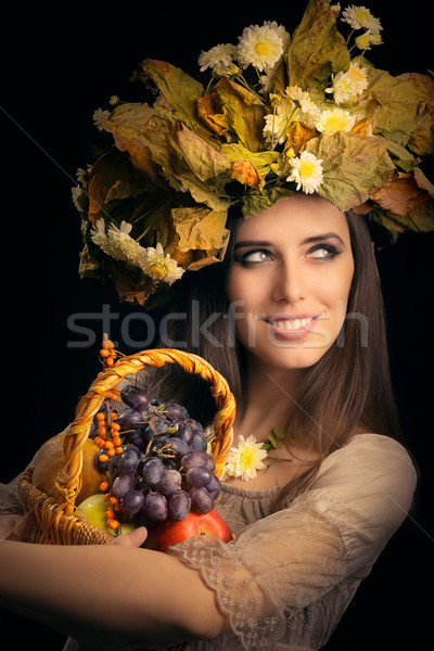 Beautiful Woman with Autumn Fruits Gift Basket Stock photo © NicoletaIonescu
