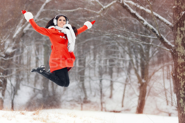 Happy Winter Woman Jumping in the Snow Stock photo © NicoletaIonescu