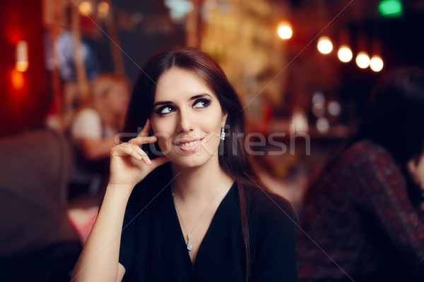 Smiling Woman at a Social Party in a Pub Stock photo © NicoletaIonescu