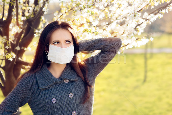 Woman with Respirator Mask Fighting Spring Allergies Outdoor Stock photo © NicoletaIonescu