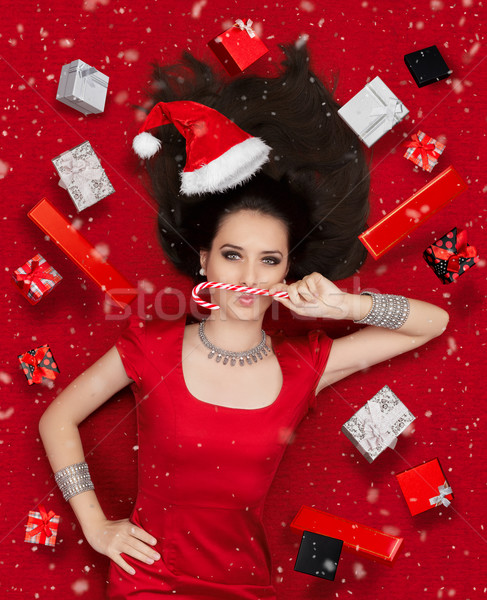 Funny Christmas Girl with Candy Cane surrounded by Presents  Stock photo © NicoletaIonescu