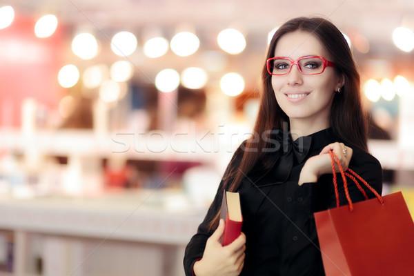 Mosolyog lány visel szemüveg vásárlás könyvek Stock fotó © NicoletaIonescu