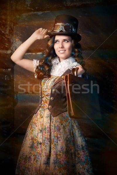 Steampunk fille cuir portefeuille sac portrait Photo stock © NicoletaIonescu