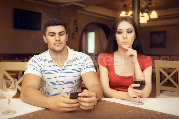 Curious Girl Spying Boyfriend on Smartphone Stock photo © NicoletaIonescu