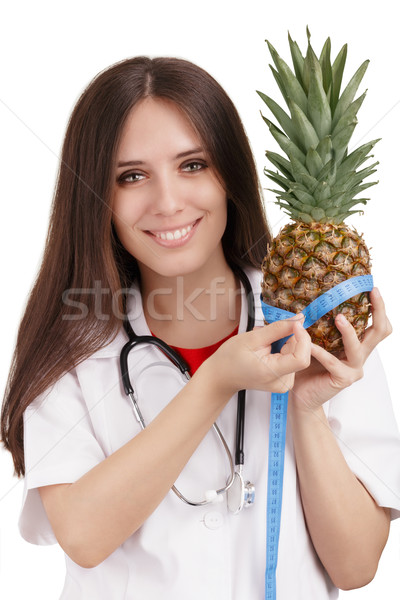 Nutritionist Doctor Measuring a Pineapple Fruit Stock photo © NicoletaIonescu
