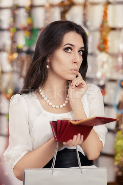 Cute Broke Woman at  Shopping Checking Wallet Stock photo © NicoletaIonescu