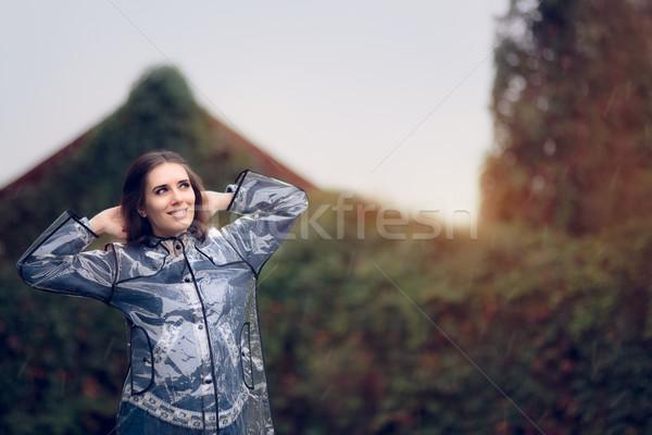 Happy Woman in Raincoat Enjoying the Rain Stock photo © NicoletaIonescu
