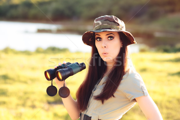 Surprised Explorer Girl with Camouflage Hat and Binoculars  Stock photo © NicoletaIonescu