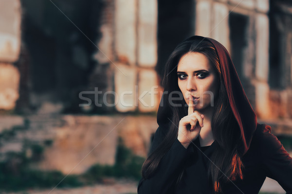 Halloween Woman Keeping a Secret in Front of a Ruins Stock photo © NicoletaIonescu