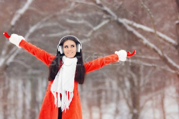 Happy Winter Girl with Headphones Enjoying Snow Stock photo © NicoletaIonescu