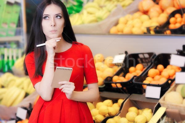 Curious Woman in The Supermarket with Hopping List Stock photo © NicoletaIonescu