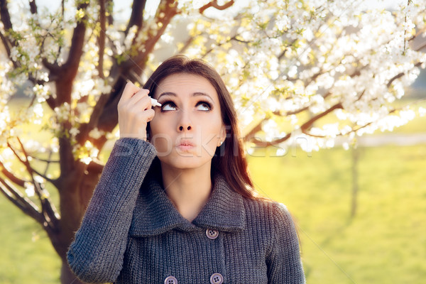 Woman with Spring Allergies Using Eye Drops Stock photo © NicoletaIonescu