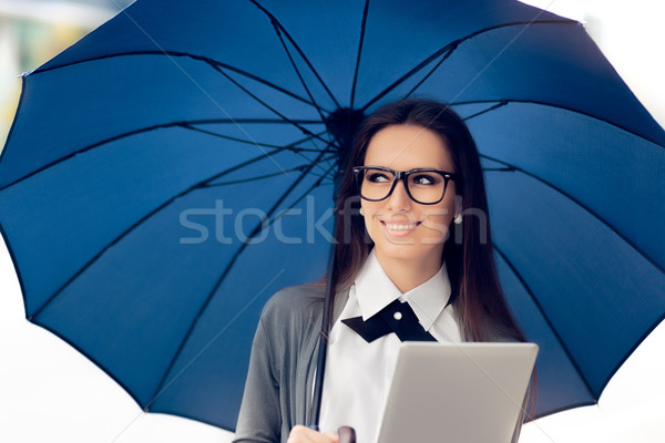 Happy Woman with Glasses, Tablet and Umbrella Out in the City Stock photo © NicoletaIonescu