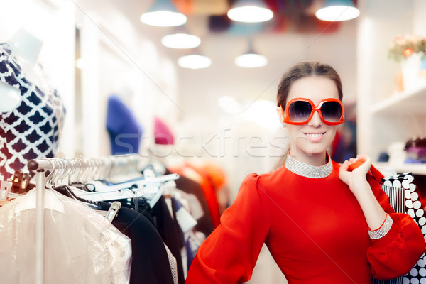 Elegant Woman with Big Sunglasses and Shopping Bags Stock photo © NicoletaIonescu