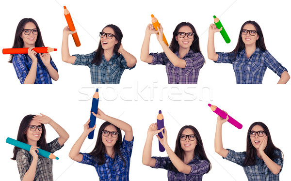 Girl with Glasses Holding Giant Pencils in Multiple Colors  Stock photo © NicoletaIonescu