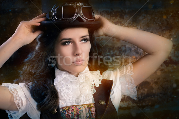 Steampunk Girl with Top Hat and Aviator Glasses  Stock photo © NicoletaIonescu