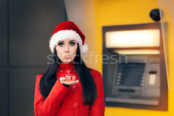 Teleurgesteld vrouw klein geschenkdoos atm triest Stockfoto © NicoletaIonescu