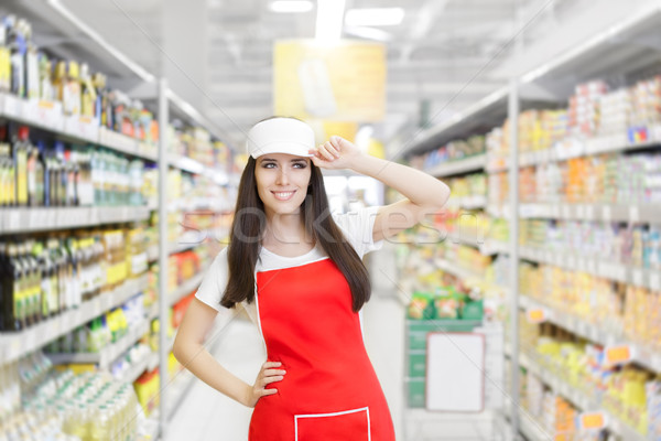 Smiling Supermarket Employee Standing Among Shelves Stock photo © NicoletaIonescu
