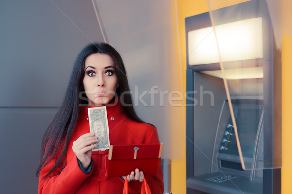 Broke Woman Holding One Dollar in Front of an ATM  Stock photo © NicoletaIonescu