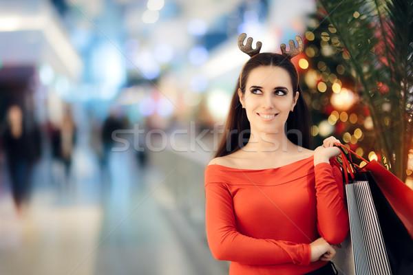 Shopping Woman Wearing Christmas Reindeer Horns Headband Stock photo © NicoletaIonescu