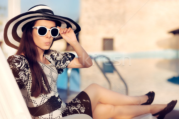 удивленный девушки Солнцезащитные очки Hat сидят солнце Сток-фото © NicoletaIonescu