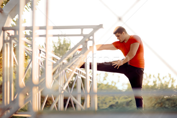 Athletic Man Stretching Before Workout Stock photo © NicoletaIonescu